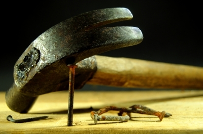 Hammers use leverage to remove nails.